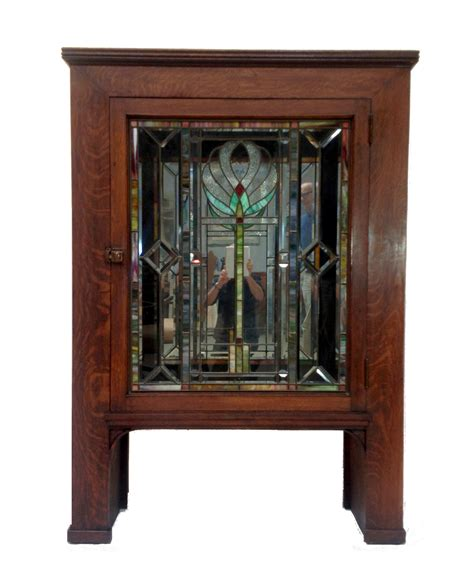antique glass door cabinet antique craftsman cabinet with stained glass door chairish
