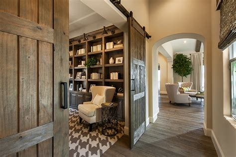 home building trends camelot homes plan your dream house with barn doors
