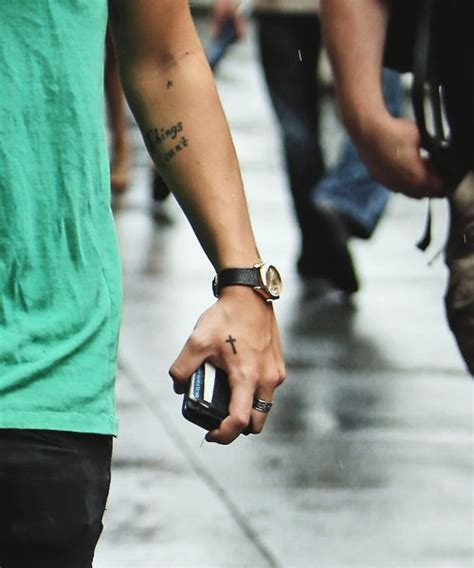 tattoo harry styles hand harry styles cross tattoo on his hand
