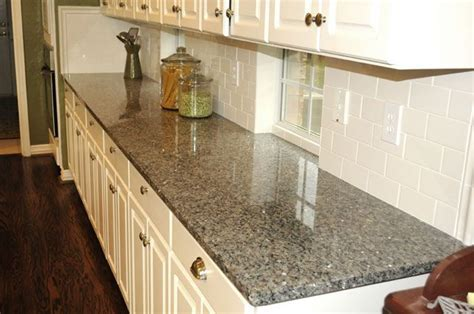 new caledonia granite for bathroom counters with white