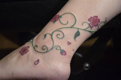 rose tattoo around ankle vine tattoos designs ideas and meaning tattoos for you