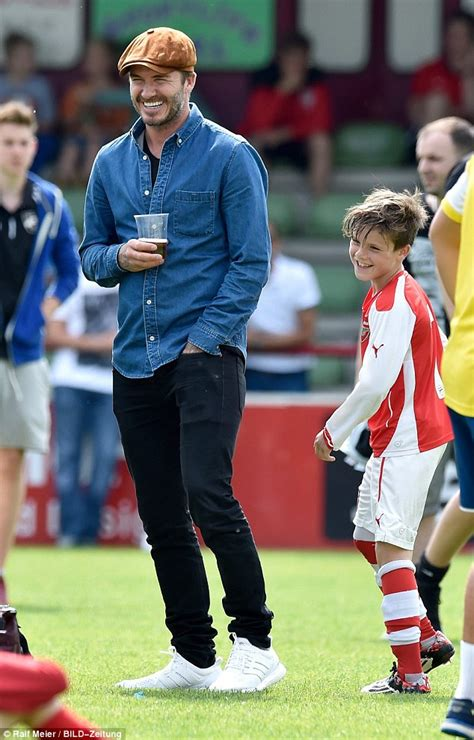 Pomade Romeo beckham receives a hug from david during arsenal