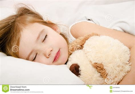 Nel Images by Adorable Sleeping In The Bed Stock Image