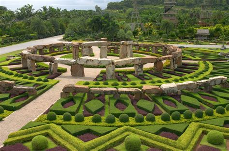 extensive topiary gardens with many geometric shapes
