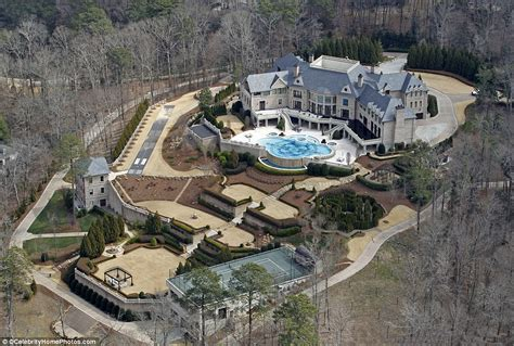 perry opens the doors to atlanta mansion as he puts