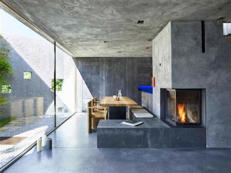 tiny concrete bunker opens to reveal a 3 story home