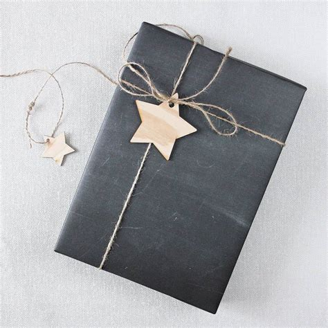 wrapping a gift chalkboard gift wrap by newton and the apple