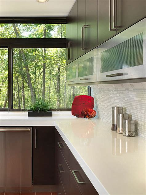 modern kitchen with glass tile andcustom cabinetry