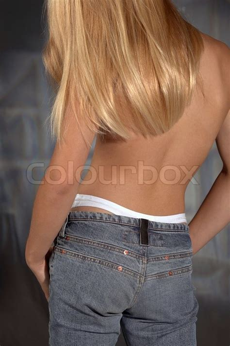 hair from behind a young girl with long blond hair and naked upper part of
