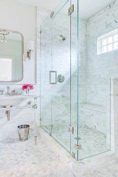 A Brass And Lucite Towel Holder Lines A Glass And Marble Perspex Shower Doors
