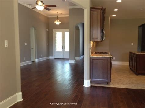 sherwin williams greige with the darker shade spalding grey as accent walls of