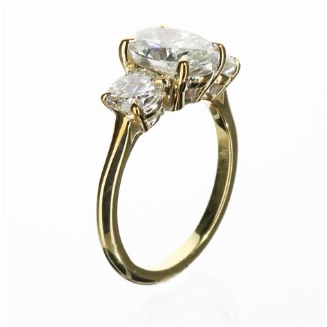 Three Stone Oval Engagement Ring in 14 Karat Yellow Gold