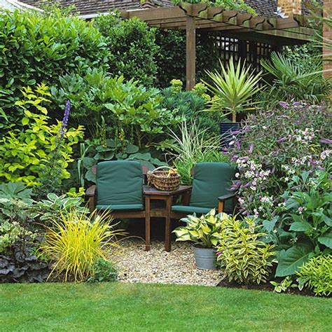 Backyard Sitting Area Ideas by Cosy Seating Area For Two Surrounded By Large Leaved