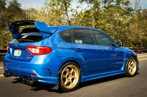 blue subaru gold rims subaru impreza sti gold rims speeding subies