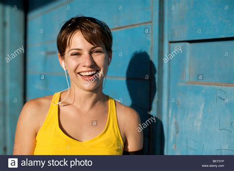 professional looks for female in mid 20s woman in her late 20 s wearing her workout clothes and