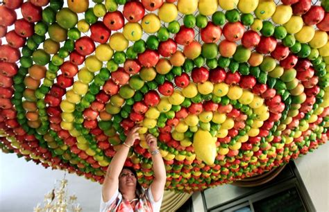 Woman from the samaritan sect decorates with fruits and vegetables a