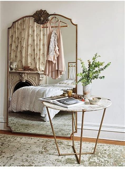 anthropologie mirror and gold mirrors on