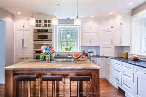 White country kitchen remodel with chrome barstools featured at