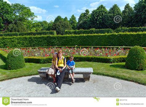 children s park bench family in summer city park royalty free stock image