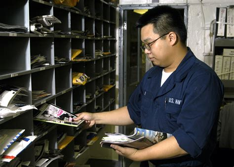 file us navy 051006 n 7748k 003 postal clerk seaman antoine le sorts mail in the post office