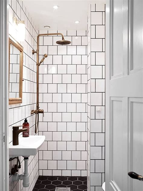 white bathroom tiles with black grout how to pull off this easy to clean affordable trend