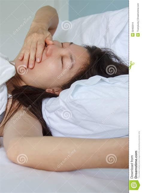 woman sleeping in bed woman sleeping in bed stock images image 32402314