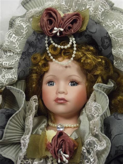 porcelain doll green dress porcelain doll elaborate green dress feathers in