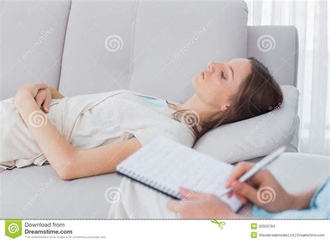 lying on couch pensive woman lying on the couch while psychologist