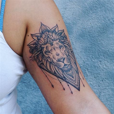 geometric lion tattoo by ray mandal look at that dotwork