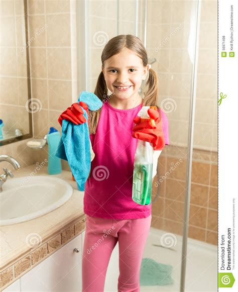 girls doing in bathroom cute girl doing cleaning at bathroom holding rag and spray