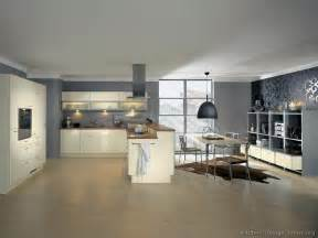 amazing Wall Color Ideas For Kitchen With Dark Cabinets #1: kitchen-cabinets-modern-cream-antique-white-007-A086a-gray-walls-wood-floor-peninsula-hood.jpg