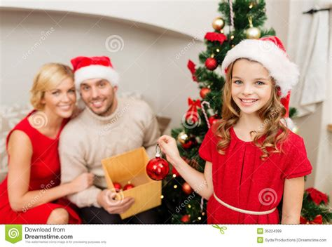 Family Natal I Do smiling family decorating tree royalty free stock images image 35224399
