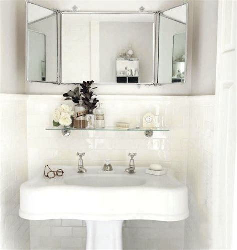 powder room with pedestal sink chic small powder room with glossy white pedestal sink