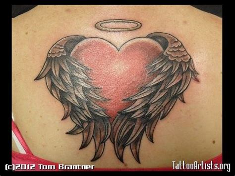 rose tattoo with angel wings shaped wings tattoos