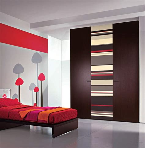 tips on choosing home furniture design for bedroom striped wardrobe design with red bed ideas for single