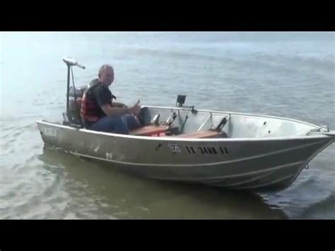 10ft jon boat with 4hp 4 hp mercury outboard running on a 12 foot john boat