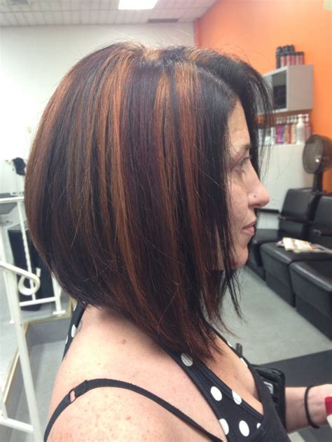 long stacked bob red base with brown and blonde highlights and long stacked