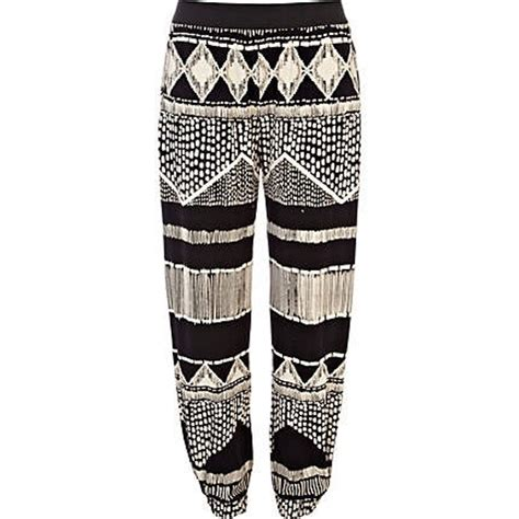 black and white patterned joggers river island black and white aztec print jogger trousers