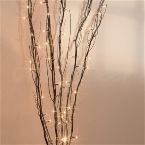 Lit Twigs In Vase by Lit Twig Lights