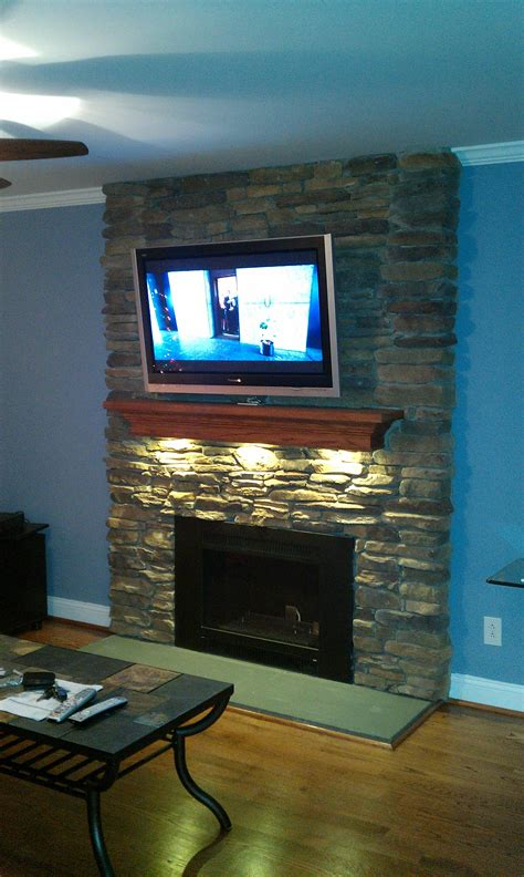 led puck lights under your fireplace mantel diy fireplace