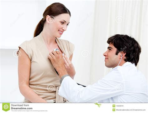 doctor examining woman male doctor examining a female patient royalty free stock