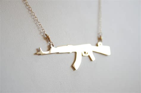 ak 74 not 47 gold gun necklace