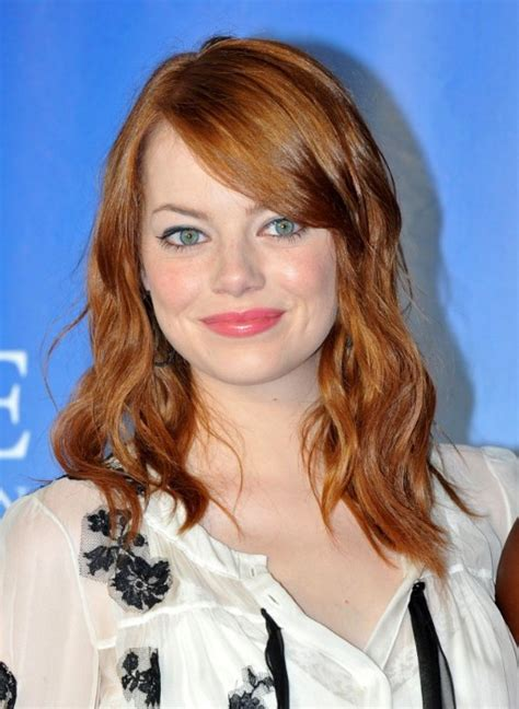 medium length brown hair with bangs and blonde highlights emma stone medium brown wavy hairstyle with side bangs