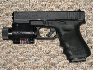 file glock model 23 with tactical light and laser sight