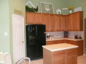 painting ideas kitchen walls my clients current kitchen with oak cabinets and green walls