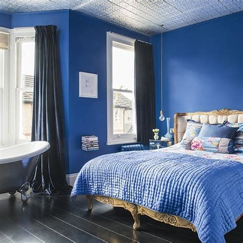 bedroom with blue walls romantic bedroom with sapphire blue walls and gold bed