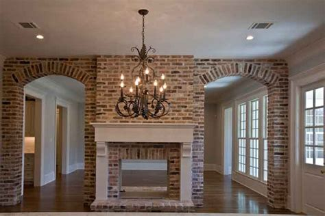 fireplace in dining room instead of living room lovely view of brick arches and see through fireplace from