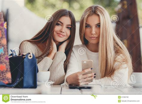Beautiful Blogging Friends 2 two are photos on smartphone stock photo
