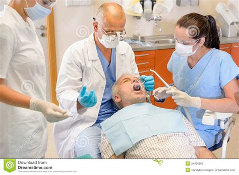Has Surgery by Senior At Dentist Surgery Operation Stock Image