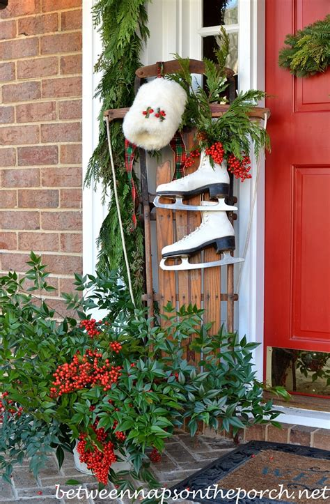 used christmas decorations outdoor decorating the porch for with garland sled skates and snowflake wreath